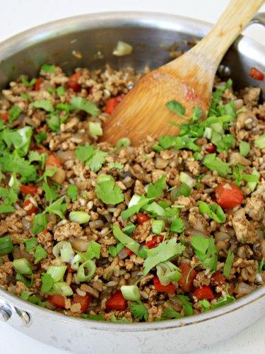 ground turkey with garnish for healthy turkey lettuce wraps