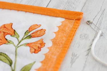 These eco-friendly bags can be made from fabric you already have or thrift shop dishtowels or curtain panels to make them double earth friendly.