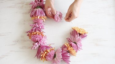 String flowers together with needle