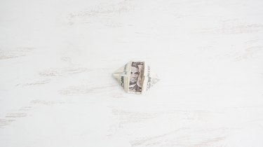 Folding corners of bill