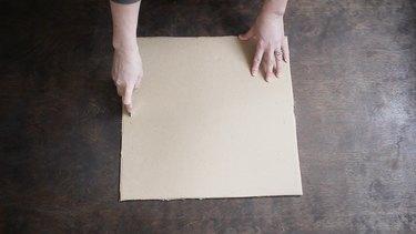 Cutting slits on each side of cardboard