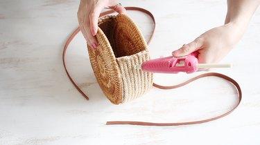 Gluing purse strap to purse