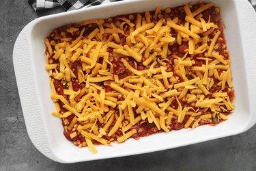Add chili and cheese to casserole dish