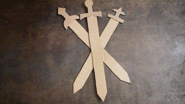 Three cardboard swords