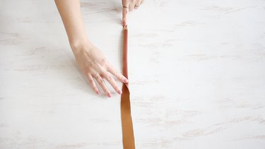 Gluing purse strap together