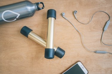 DIY gold and black dumbbells with PVC pipes