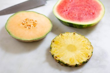 Flat discs of sliced pineapple, watermelon and cantaloupe