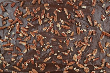 Add frosting and pecans