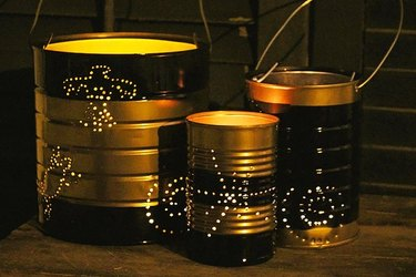 Three artistic DIY lanterns made from empty cans