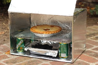 DIY camp oven made from a cardboard box and foil