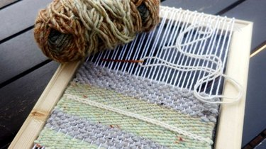 Homemade loom with half-woven design