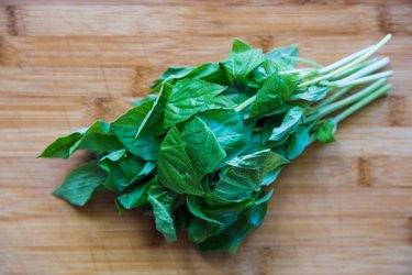 Fresh basil on a cutting board
