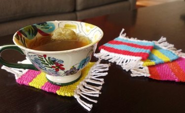 Cup of tea sitting on woven coaster