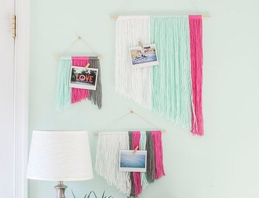Three yarn wall hangings