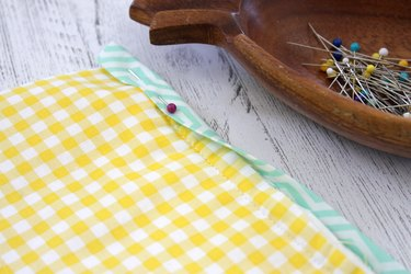 Sew a double pot holder so you can slide your hands into each of the pockets and grab that hot pan right out of the oven.