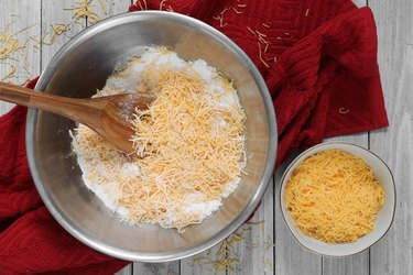 Combine flour, sugar and cheese