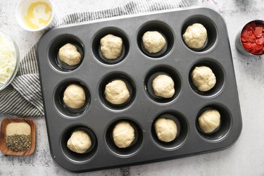 Form pizza dough into balls