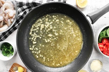 Simmer broth or white wine
