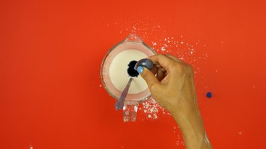 Adding food coloring to starch mixture for  DIY Sidewalk Squirt Chalk
