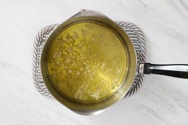 Cook garlic in olive oil