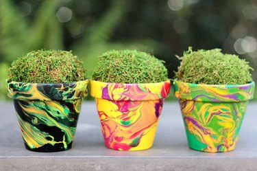 Colorful clay pots painted in a marbleized pattern