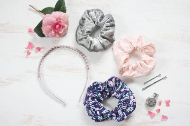 Three hair scrunchies in different fabric types