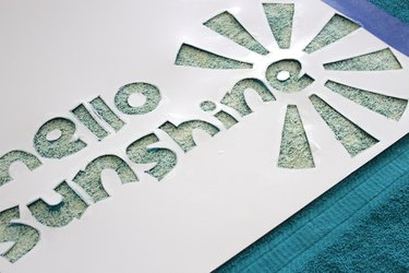 Make a fun fashion statement this summer by creating your own customized beach towel design with bleach.