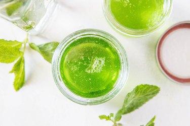 Open jar of mint jelly