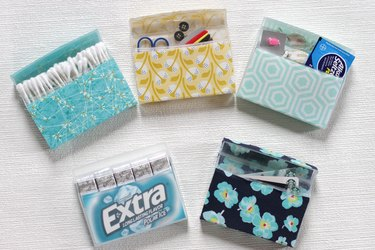 Transform empty plastic gum holders into first aid kits, sewing kits, gift card holders, and q-tip holders.