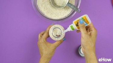 "Using super glue to seal bottle cap of DIY ""I Spy"" Bottle Travel Toy"
