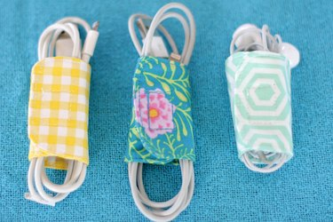 Keep those cords under control and detangled with these cute cord holders that you made yourself from a couple of pieces of scrap fabric.