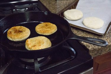 Papusas cooking in a skillet