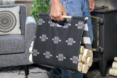 Instead of getting dirty while carrying firewood, do it in style with this DIY fabric carrier.