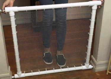 Placing DIY PVC Pipe Pet Gate at end of hallway
