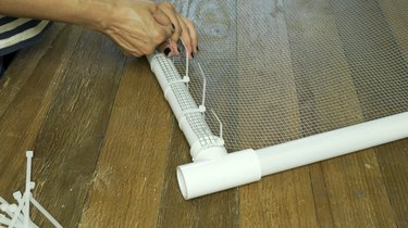 Fastening hardware cloth steel mesh to PVC frame with cable ties for DIY PVC Pipe Pet Gate