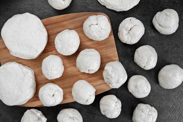 Roll biscuit dough into balls