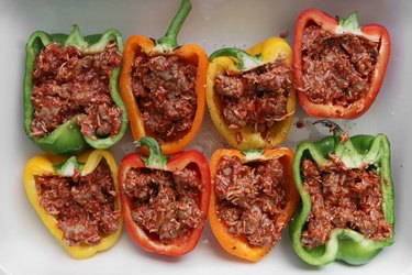 Fill bell peppers with sausage