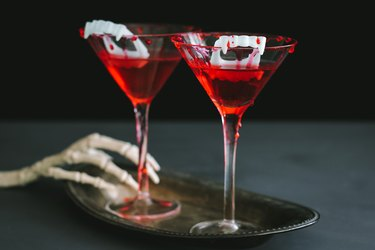 Halloween vampire cocktail with blood dripping