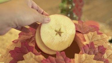 Adding sliced apples to Pumpkin Pie Punch
