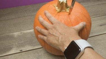 Removing top of pumpkin to make DIY Pumpkin Keg