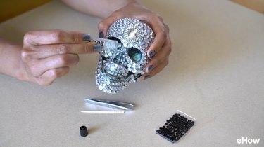 Encrust Eye Holes and Nose Hole with Darker Gemstones