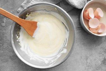 Fold egg whites and yolks