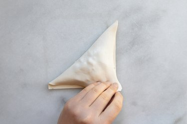 Fold the pastry to form a triangle.