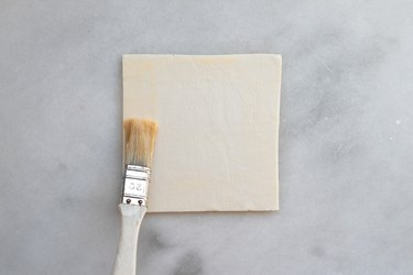 Brush the edges of the pastry with the egg wash.