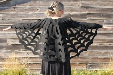 Embrace your spooky side, add a little mystery to your wardrobe and you might even catch some fun in your web when you wear this easy-to-make, no-sew, felt spider web poncho.