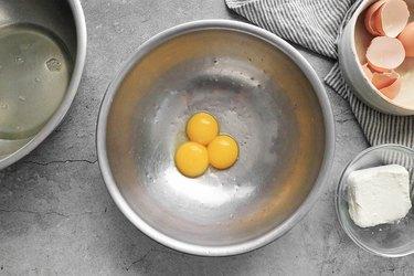 Separate egg yolks and egg whites