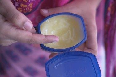 women hand using vaseline