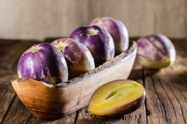 South American fruit muricatum solanum or cucumber sweet or cucumber melon. Pepino dulce o pepino melon in clay bowl