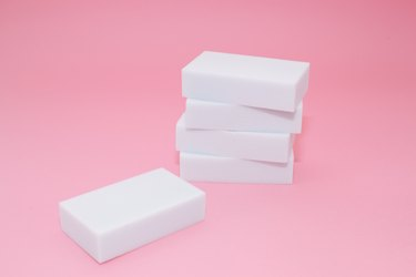 Melamine sponge stack on pink background