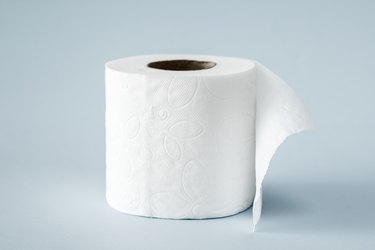 White roll toilet paper on the  light blue background